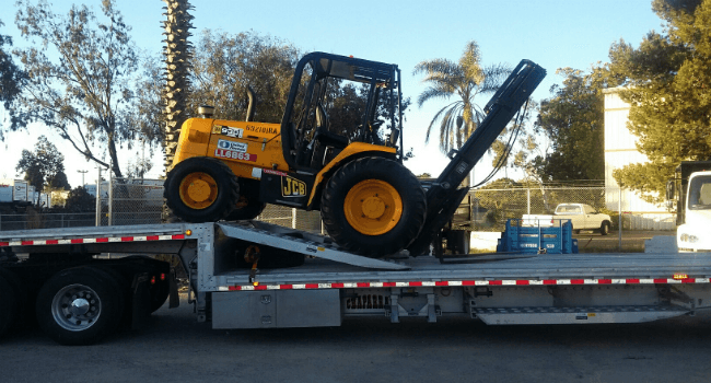 Forklift on stepdeck trailer