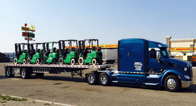 Forklifts on flatbed trailer
