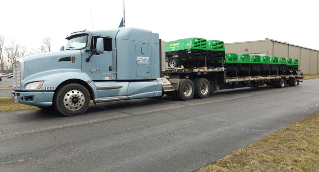 Generators on stepdeck trailer