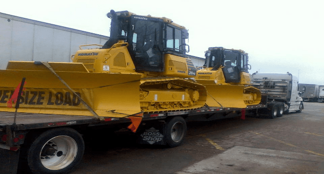 Dozer wide load on stepdeck trailer